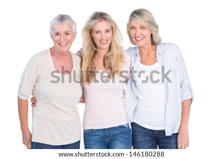 Three generations of women smiling at camera on white background - stock photo