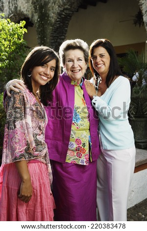 Three generations of women smiling for the camera - stock photo