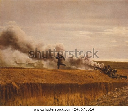Three German anti-tank gun soldiers on hill, with smoke from flaming vehicle in background. Ca. 1939-45. WW2 in Russia. - stock photo