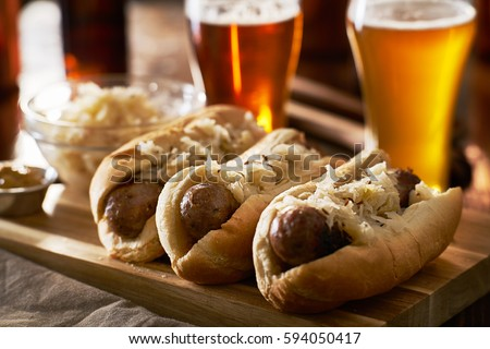 three german bratwursts and sauerkraut with beer