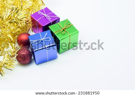 Three gift box with red ball and golden garland - stock photo