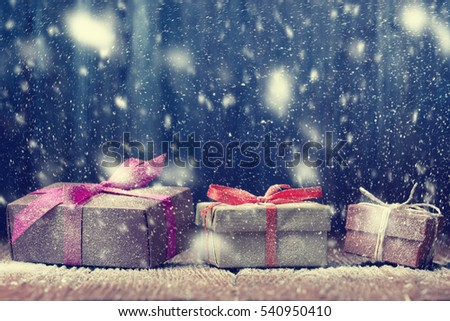 Three gift boxes on snowy background