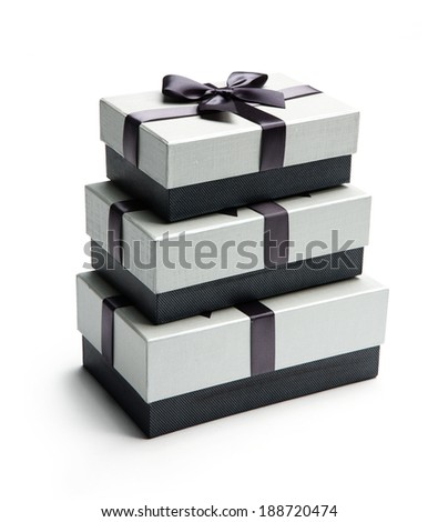 Three giftboxes / studio photo of black and white box wrapping ribbon with bowknot - on white background  - stock photo