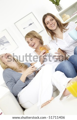 three girlfriends having breakfast