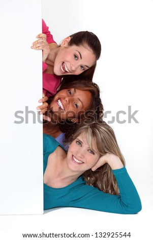 three girlfriends posing together - stock photo