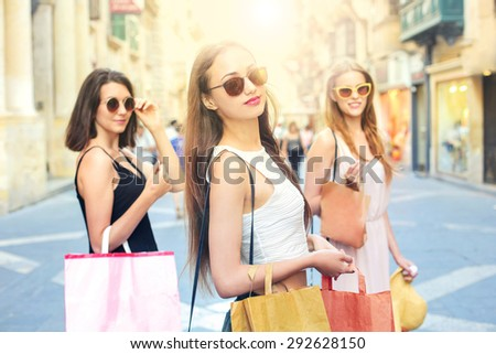 Three girls in a shopping day - stock photo