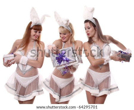 Three girls in suits of a hare look gifts - stock photo