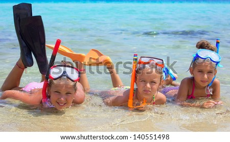 Three girls in the tropical sea - stock photo