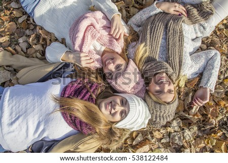 Three girls laying on the ground