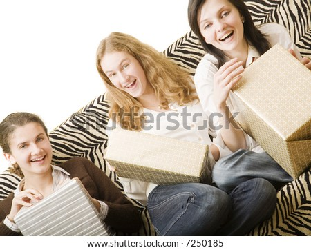three girls on the sofa with gifts