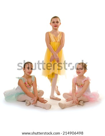 Three Girls Pose in their Ballet Dance Recital Costume - stock photo