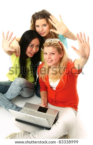 Three girls sitting on the floor with with bye-bye gesture. isolated on white background. Top view - stock photo