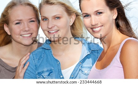 Three girls spending time outside - stock photo