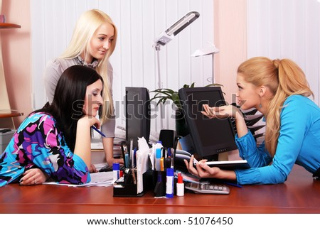 Three girls working in the office - stock photo