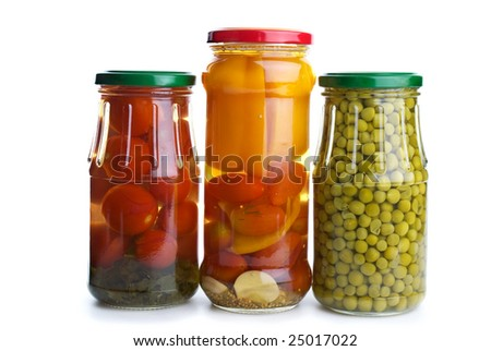 Three glass jars with marinated vegetables (green peas, tomatoes, bell pepper, e.t.c.) isolated on the white background - stock photo