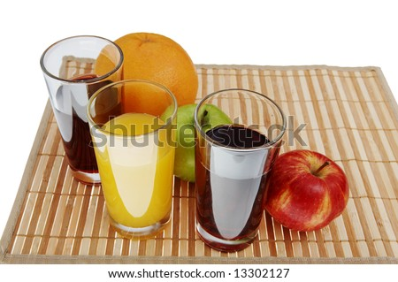 Three glass of juice and green, red apple, grapefruit - stock photo