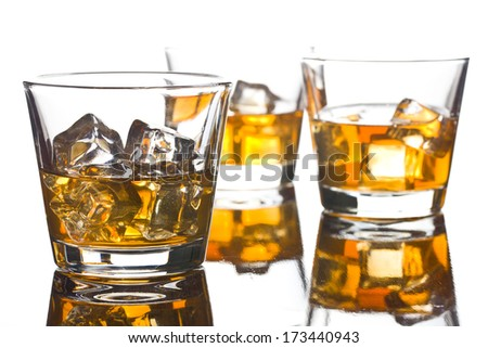 three glass of whiskey on white background