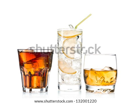 Three glasses of alcoholic and soft drinks - stock photo