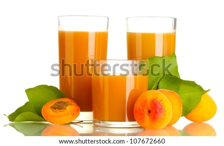 three glasses of apricot juice and apricots with leaf isolated on white