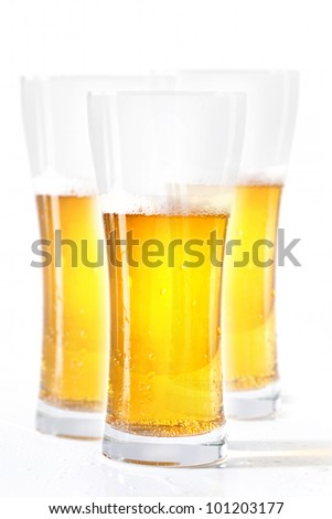 three glasses of beer on white background