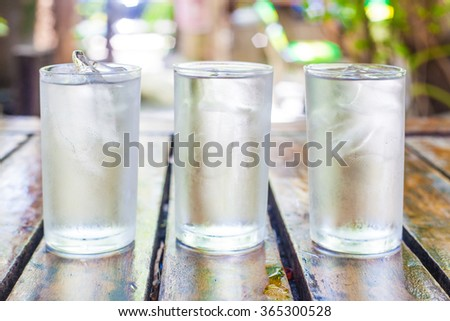 Three glasses of clean drinking water. - stock photo