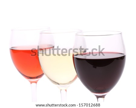 Three glasses of wine.  Isolated on a white background - stock photo