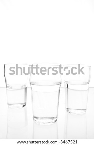three glasses on a light table