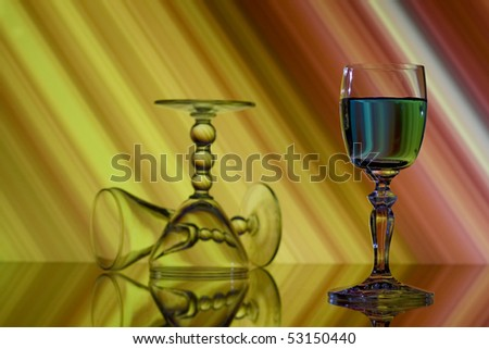 Three glasses on abstract yellow and red background - stock photo