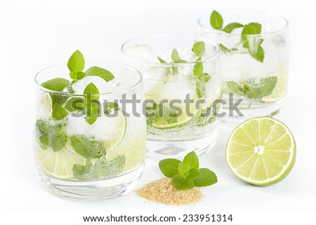 Three glasses with Mojito cocktail on a white background - stock photo