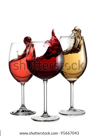 Three glasses with red, rose and white wine plash - stock photo