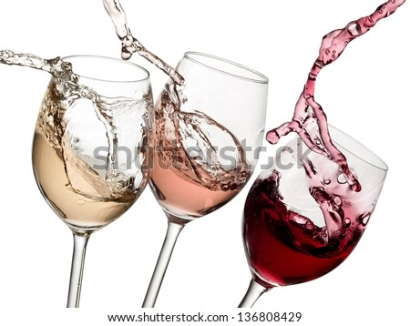 Three glasses with red, rose and white wine up