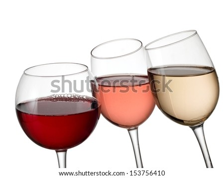 Three glasses with red, white and rose wine