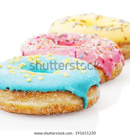 Three glazed donuts isolated on white background  - stock photo