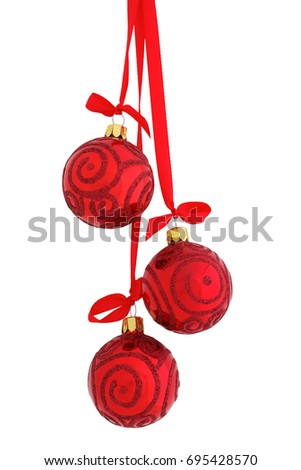 Three glossy red glass glitter Christmas baubles (decoration) hanging on a red satin ribbon with a bow, isolated on white