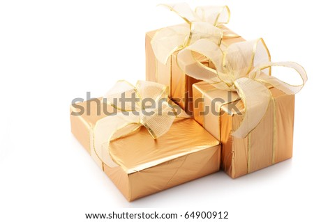 Three gold foil gifts with golden bows isolated on white background. - stock photo