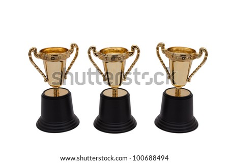 Three gold trophies isolated on white, First, Second and Third Place - stock photo