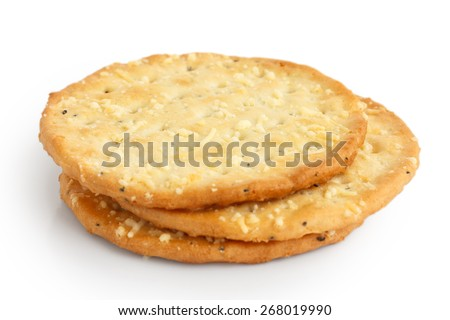 Three golden cheese crackers on white. - stock photo