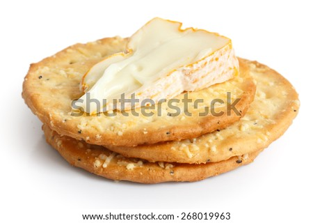 Three golden cheese crackers on white. With cheese.