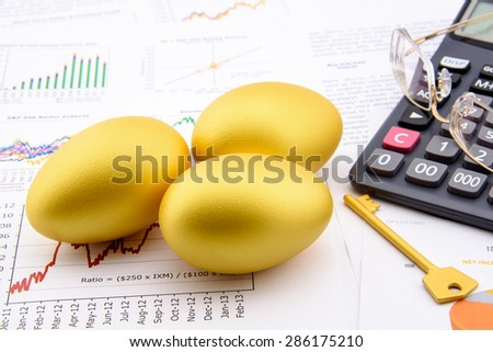 Three golden eggs and a golden key with a calculator on business and financial reports : Key success in sustainable growth investment concept - stock photo