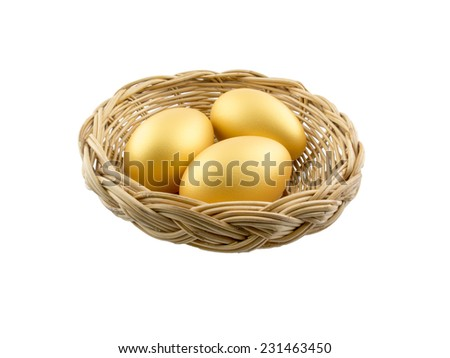 three golden eggs in the basket - stock photo