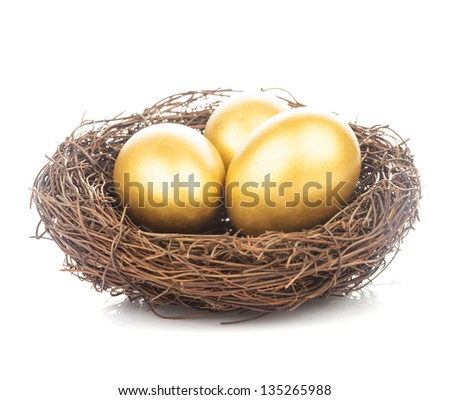 Three golden eggs in the nest isolated on white - stock photo