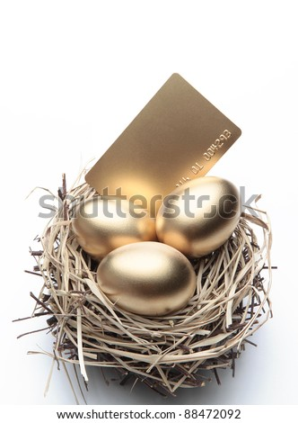 Three Golden Eggs in the Nest with Credit Card - stock photo