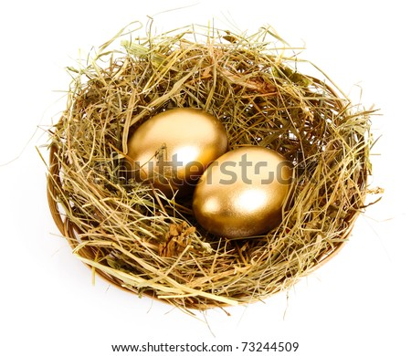 Three golden hen's eggs in the grassy nest isolated on white - stock photo