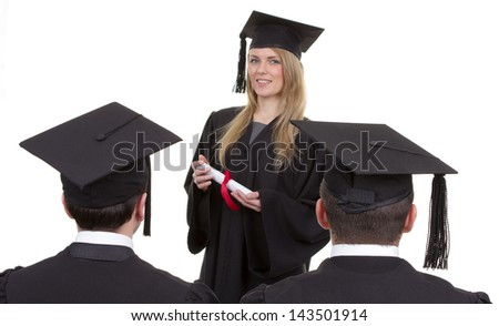 Three graduates, one standing in front of the other two, isolated on white. Shot taken using both a rear view and a front view.
