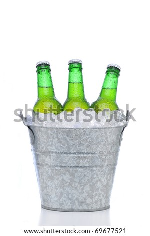Three green beer bottles in a bucket of ice isolated on a white background. Vertical format with reflection. Bottles and pail have condensation. - stock photo