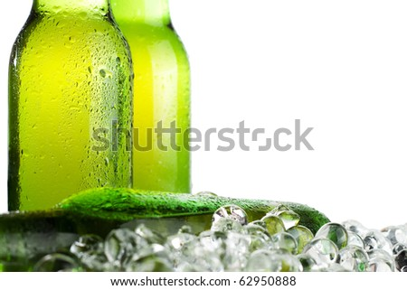 three green beer bottles with ice - stock photo