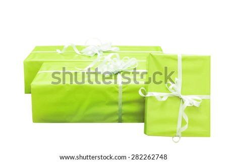 Three green gift boxes isolated on white background - stock photo