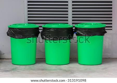 Three green plastic recycle bin  - stock photo