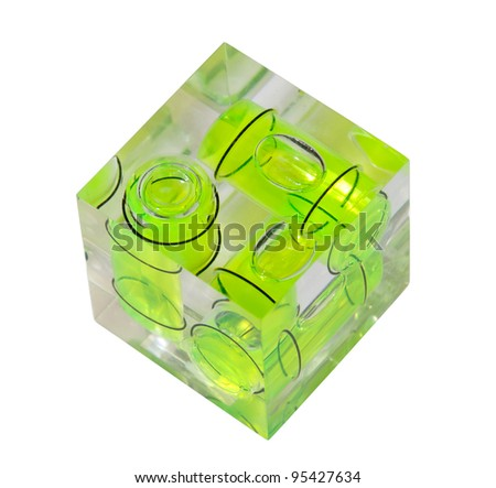 Three green spirit levels in plastic cube setting angle in any direction - stock photo