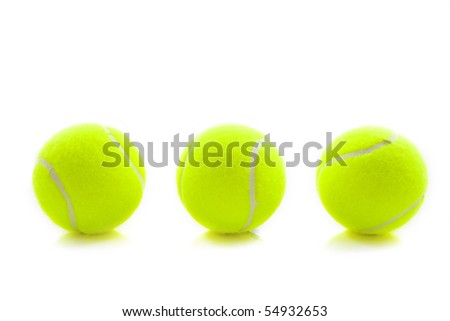 Three green tennis balls isolated over white - stock photo